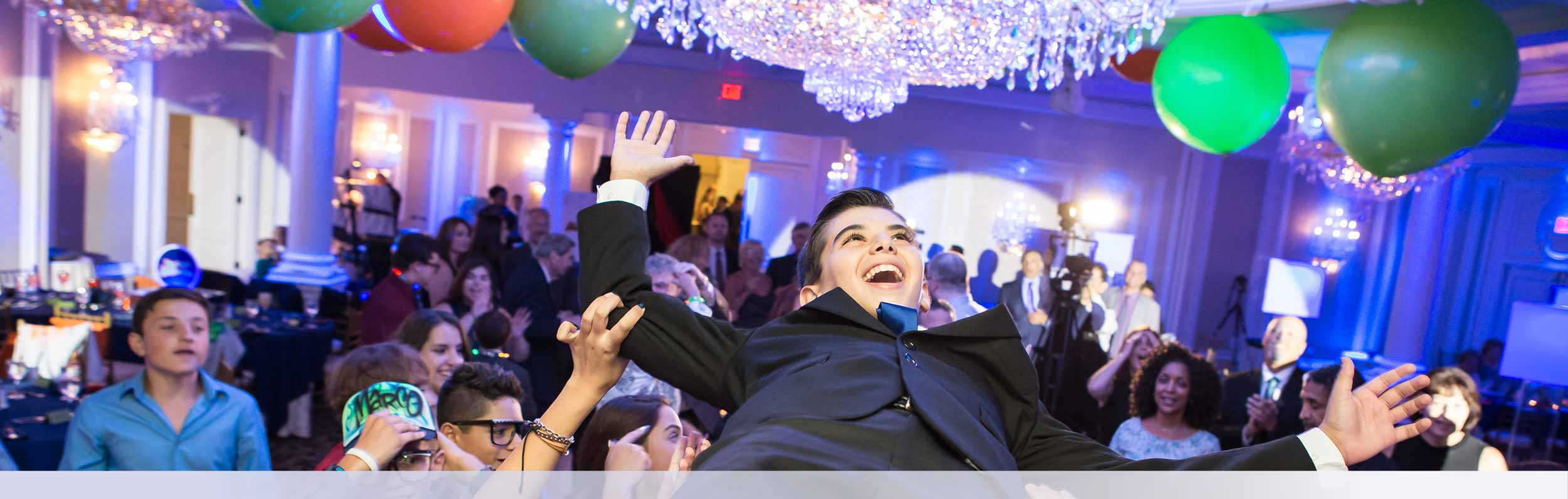 Gallery Banner 5 Teen Boy Being Lifted Bar Mitzvah