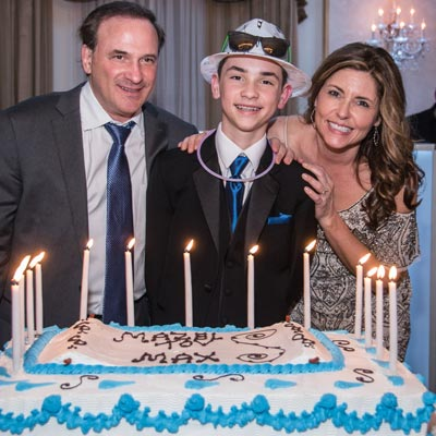 Family Celebrating Mitzvah with Cake